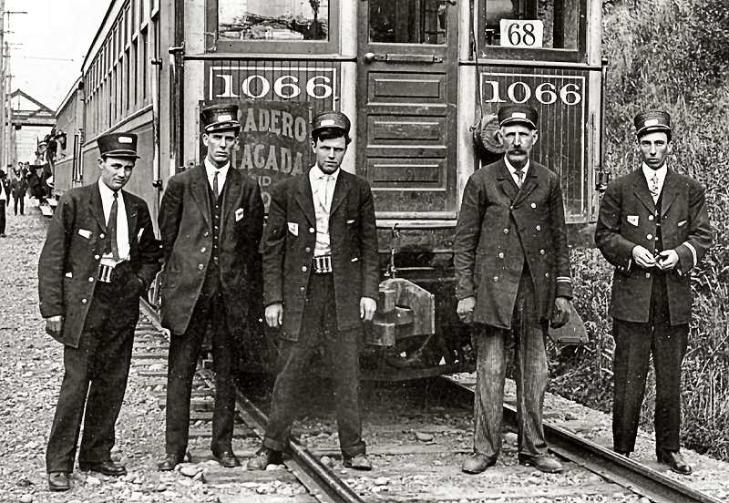 COURTESY SMILE HISTORY COMMITTEE - These conductors and motormen of the Oregon Water Power and Railway are shown in the midst of staffing a special trip out to Estacada or Oregon City. Interurban streetcar lines like this one were commonly used for long distance trips into the country. This photo was taken at Golf Junction, located at the intersection of 13th Avenue and Ochoco Street.