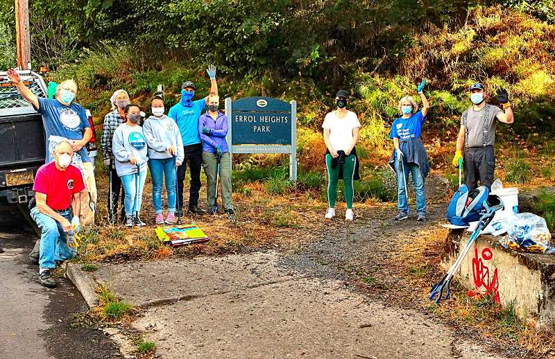 DAVID F. ASHTON - As part of this years Johnson Creek Clean-up - here at Errol Heights Park, in the Brentwood-Darlington neighborhood - a group of volunteers waved, before they headed up the trail and got to work.