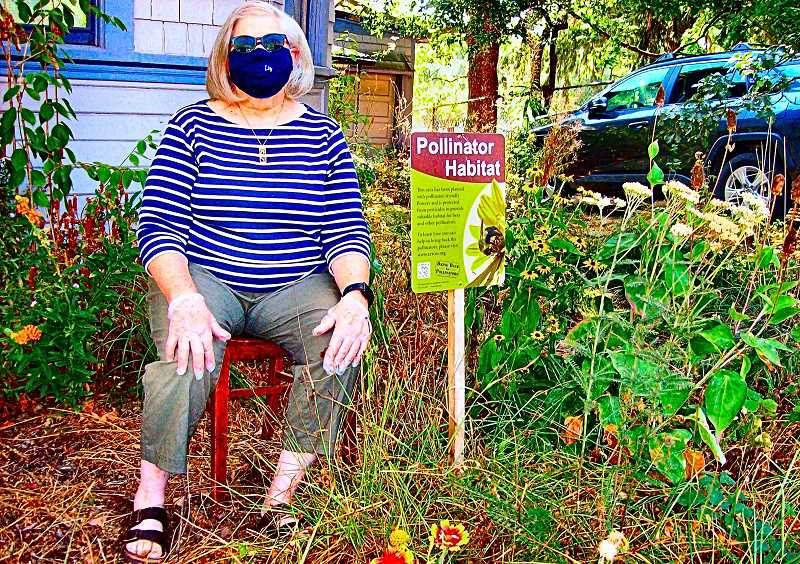 RITA A. LEONARD - Liz Dally, a resident of S.E. 10th Avenue in Brooklyn, has removed her lawn and replaced it with a garden of plants beneficial to pollinator bees.