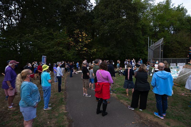 PMG PHOTO: CLARA HOWELL - There was a decent turnout of Lake Oswego community members during the rally near Hallinan Woods Sept. 21.
