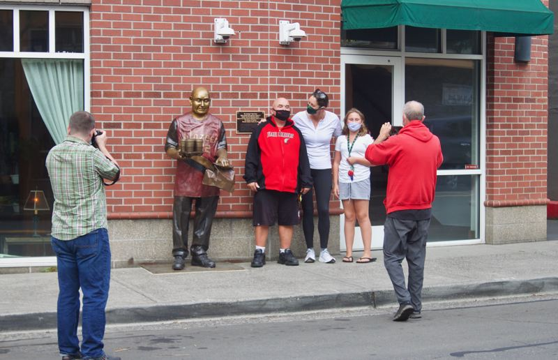 PMG PHOTO: CHRISTOPHER KEIZUR - Many community members stopped by to check in on Todd Kirnan and take photos with him.