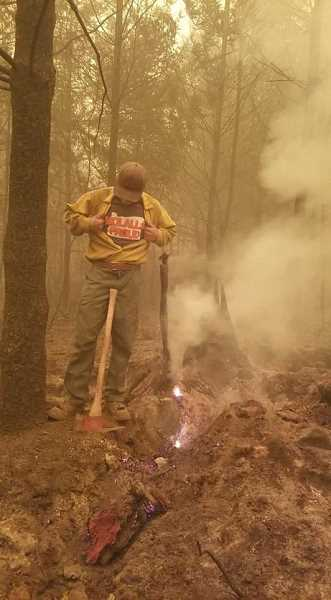 COURTESY PHOTO: STL - Logan Pritchard shows off a Molalla Proud shirt amidst the September 2020 Clackamas County wildfires.
