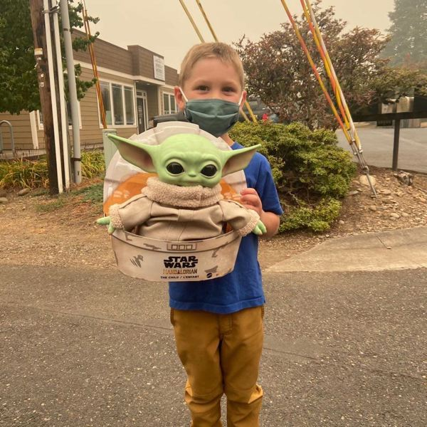COURTESY PHOTO - Scappoose resident Carver, age 5, donated a Baby Yoda plush to crews on the frontline of Oregon wildfires.