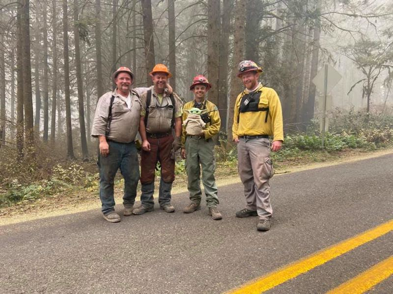 COURTESY PHOTO - Crews working on the Riverside Fire are all smiles with Baby Yoda.