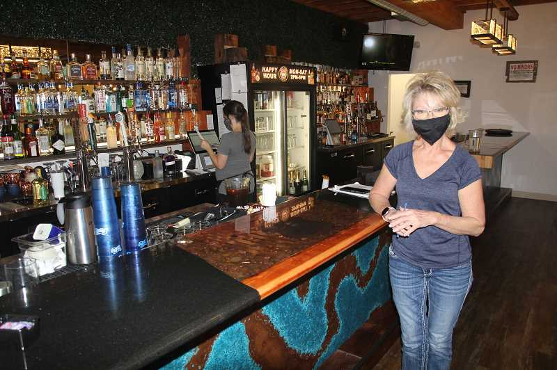 PMG PHOTO: JUSTIN MUCH - Veteran regional restaurateur Annette Day stands before the bar of her recently opened Route 99 bar and grill in Brooks. Day, who owned and operated Annette's Westgate Cafe in West Salem and Creekside Deli in Keizer, grew up in the Lake Labish area.