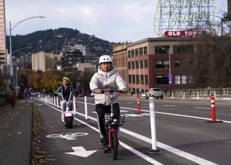 COURTESY PHOTO: PBOT - Electric scooter riders zip along the Burnside Bridge in Portland.