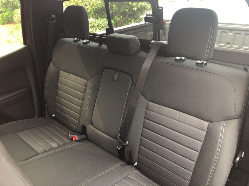 PMG PHOTO: JEFF ZURSCHMEIDE - The rear seats are on the small side but will carry two adults on reasonable trips.