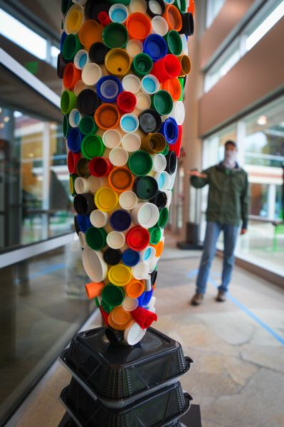 PMG PHOTO: JAIME VALDEZ - Discarded bottle caps cover a sculpture at Pacific University professor Tyler Brumfield's new exhibit 'Everyday Abstractions' at the Hillsboro Civic Center.