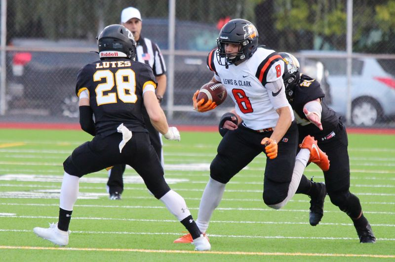COURTESY PHOTO: LCPIONEERS.COM - Lewis & Clark running back Michael Abraham (8), pictured in a 2019 game, said a fall without football games is tough. But he appreciates the opportunity to have at least some interaction with teammates and coaches.