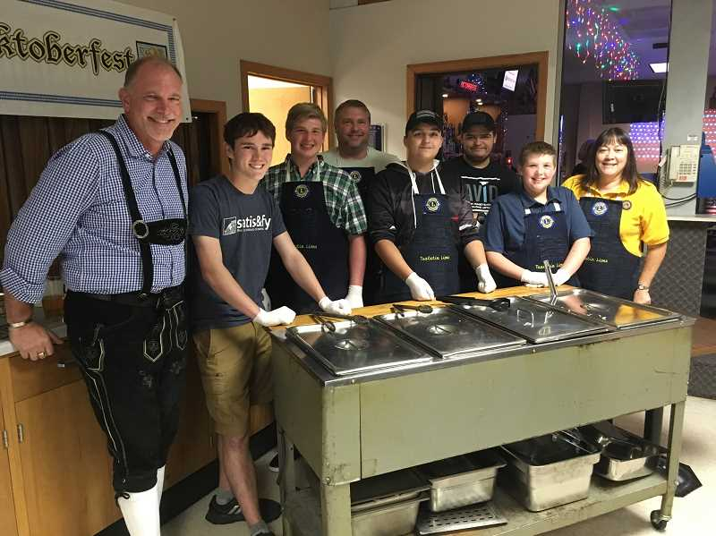 COURTESY PHOTO: TUALATIN LIONS CLUB - Brad King, left, poses with Scouts from Troop 530, who are sponsored by the Tualatin Lions Club, along with organizer/volunteers Lance Lewallen and Jackie Dannemiller.