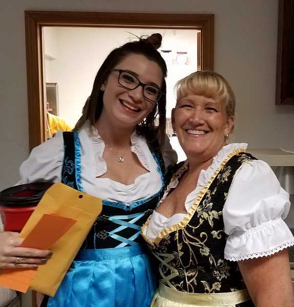 COURTESY PHOTO: TUALATIN LIONS CLUB - Jessica King-Rathmanner, left, poses with her mother, Laura King, who bakes the apfel kuchen each year for the annual Tualatin Lions Club's Oktoberfest.