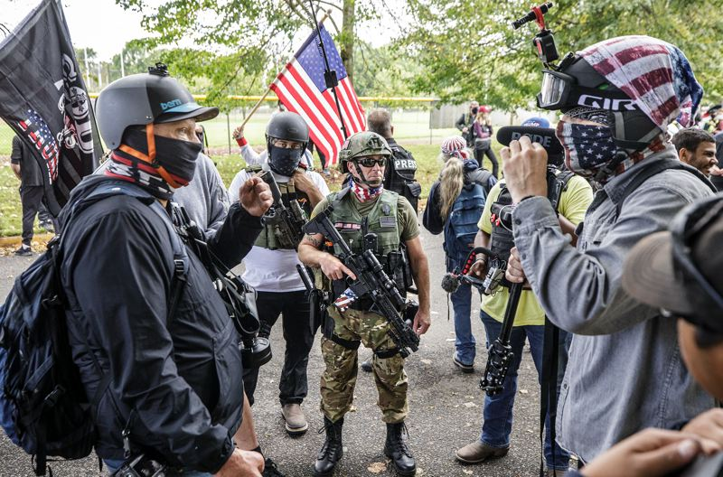 PMG PHOTO: JONATHAN HOUSE - Left and right-leaning media argue during a Proud Boys rally at Delta Park.