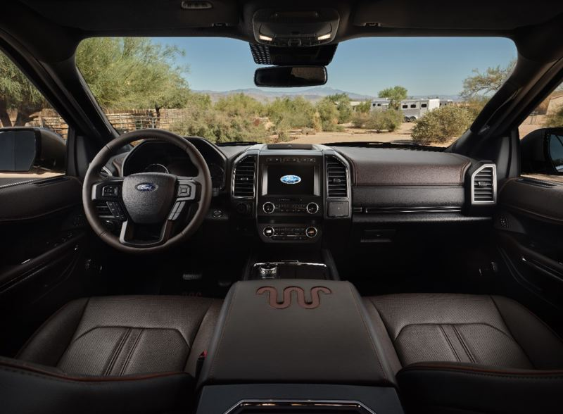 COURTESY FORD - The King Ranch version boasts a distinctive Mesa/Ebony interior with Del Rio leather seats, console and steering wheel