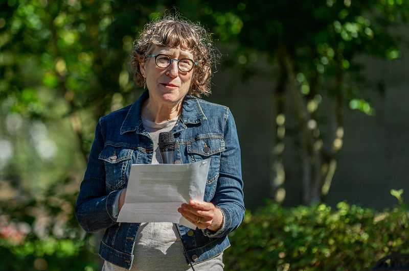 PMG PHOTO: DIEGO DIAZ - Trudy Ludwig, author of 'Gifts from the Enemy,' a children's picture book based on Alter Wiener's book, '64735: From a Name to a Number: A Holocaust Survivor's Autobiography,' speaks in front of those gathered at Synder Park Sunday to honor Wiener.