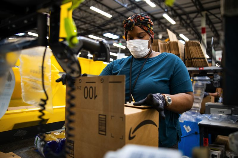 COURTESY: AMAZON - Amazon associate wearing PPE. The warehouses will be busy this year on October 14 and 15, the dates for Prime Day, which was moved becasue of the COVID-19 pandemic.