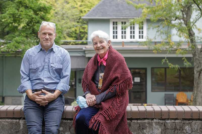 PMG PHOTO: JONATHAN HOUSE - Scott MacEachern and Joan Strong Buell of the Friends of Hopewell House organization share a visit on the grounds of Legacy Hopewell House. The hospice care home closed to the public in fall 2019, but the group hopes to revive it.