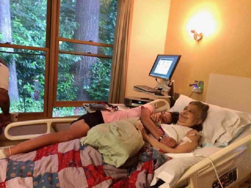PHOTO COURTESY OF FRIENDS OF HOPEWELL HOUSE AND JASMINE DESCHAINE - A patient at Legacy Hopewell House spends time with family from her bed at the Hillsdale facility. Before its closure, the hospice home served thousands of patients, providing end-of-life care.