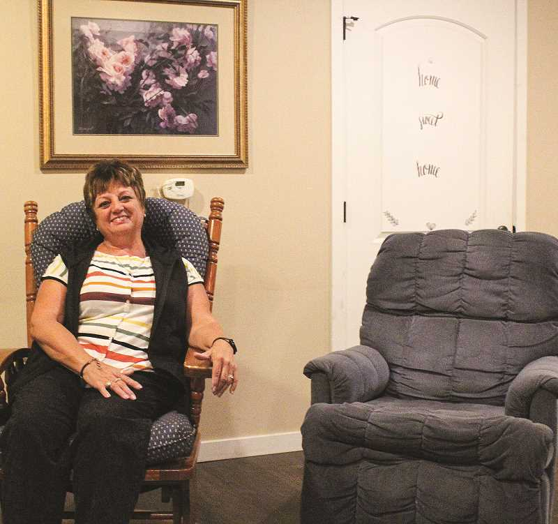 JASON CHANEY - Cindy Burback relaxes for a moment at the women's shelter, which she helped launch in the Church of the Nazarene basement.