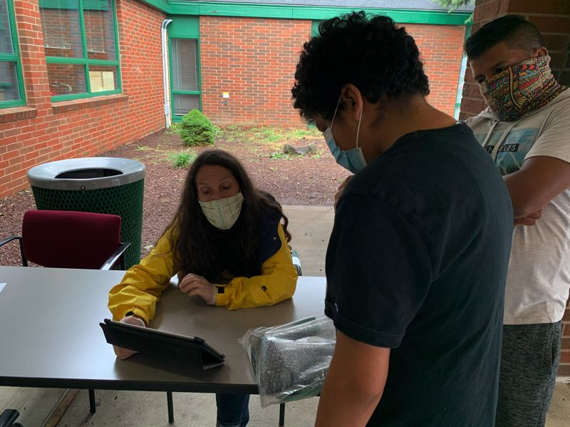 COURTESY PHOTO: TERESA CARSON - Students at Dexter McCarty and Clear Creek middle schools picked up their computer tablets to use for the 2020-21 school year after a delay due to wildfire smoke.