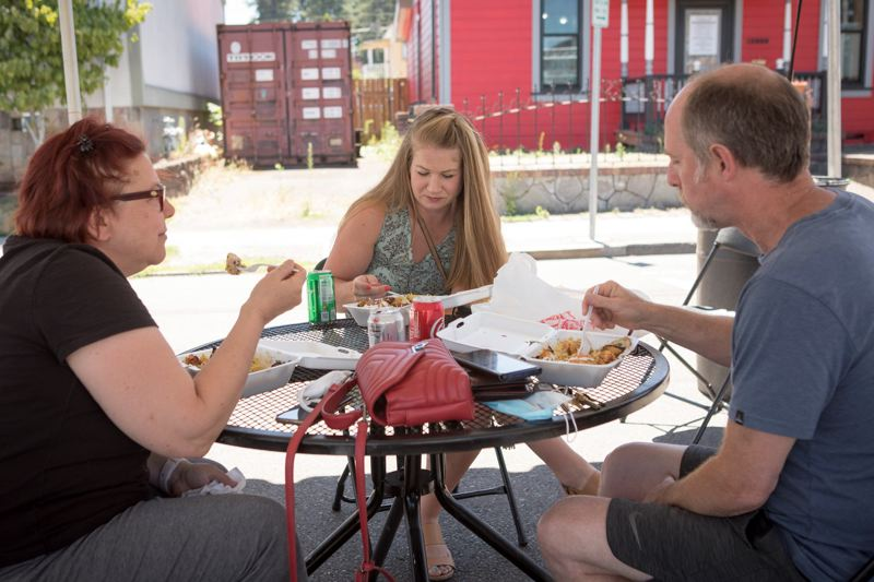 PMG PHOTO: JAIME VALDEZ - Residents enjoy the outdoor seating provided by the First Steet Dining Commons in Beaverton.