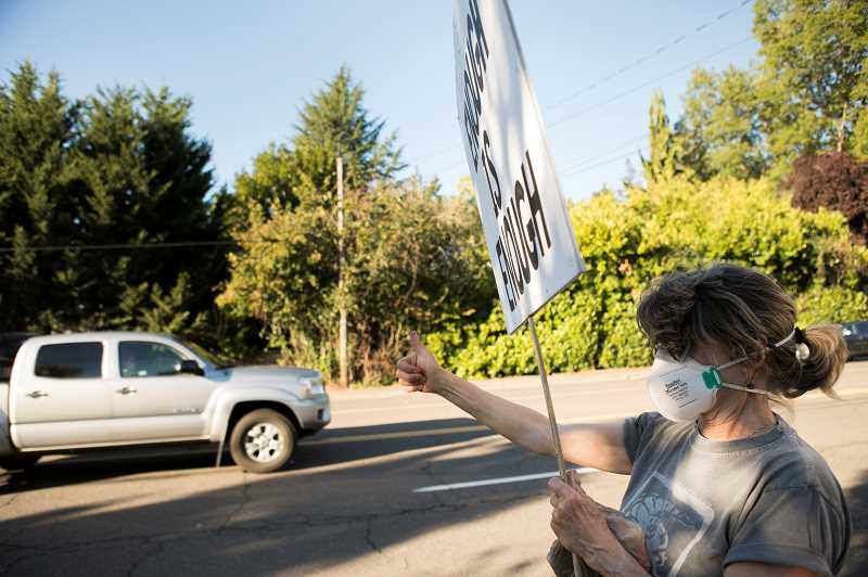 PMG PHOTO: JAIME VALDEZ - Lorraine Vinograd participates in a Black Lives Matter vigil along Beaverton-Hillsdale Highway.