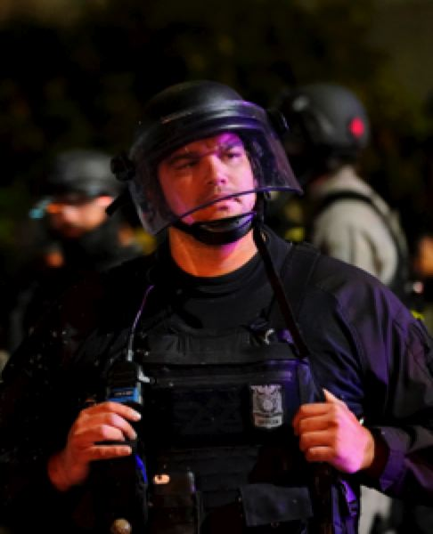 COURTESY PHOTO: KOIN 6 NEWS - A Portland police officer after dueling political protests on Saturday.