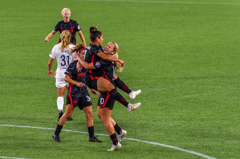 DIEGO G. DIAZ PHOTO - Rocky Rodriguez is embraced by Lindsey Horan as Thorns teammates Angela Salem and Madison Pogarch join the celebration after Rodriguez scored a stunner in Portland's 4-1 Sept. 30 win over OL Reign at Providence Park.