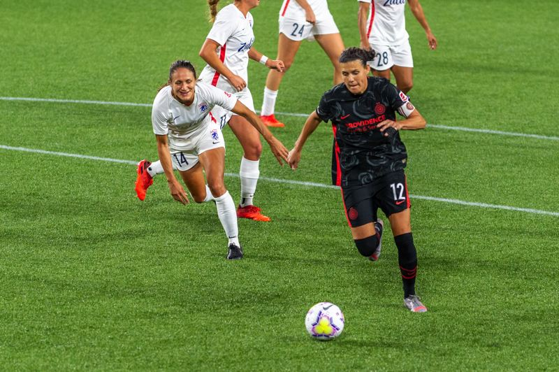 DIEGO G. DIAZ PHOTO - Christine Sinclair gets behind OL Reign defender Stephanie Cox on her way to scoring her third goal of the night as the Portland Thorns won 4-1 on Sept. 30 at Providence Park.