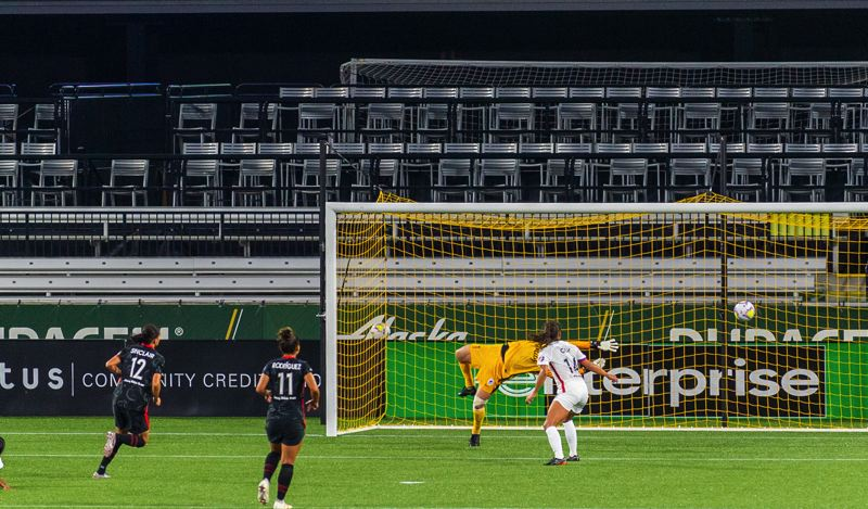 DIEGO G. DIAZ PHOTO - The first of Christine Sinclair's three goals Wednesday sails past diving OL Reign goalkeeper Michelle Betos in the first half of the Portland Thorns win at Providence Park