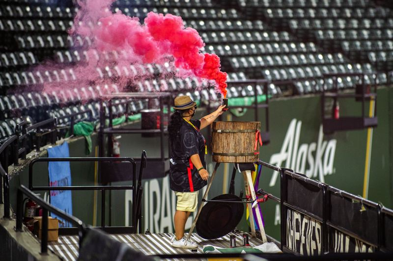 DIEGO G. DIAZ PHOTO - Even without supporters allowed at Providence Park, red smoke was released after each of the Portland Thorns four goals in Wednesday's win over OL Reign.
