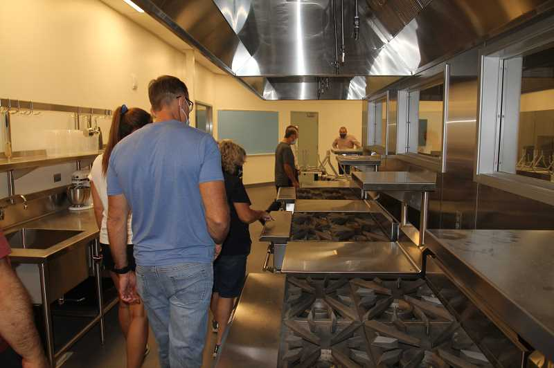 PMG PHOTO: JUSTIN MUCH - North Marion School District Bond Oversight Committee members check out the new culinary facilities at the high school during a walk through tour on Wednesday, Sept. 30.