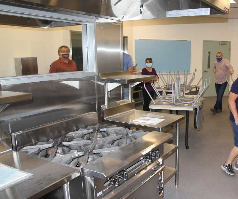 PMG PHOTO: JUSTIN MUCH - Checking out the culinary additions. North Marion School District officials tour the campus to get a close-up look at renovations at all the schools.