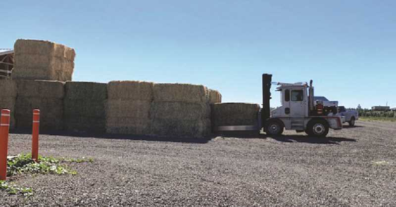 COURTESY PHOTO: MIKE BONDI - Hay is unloaded and ready for distribution to those in need up and down the Willamatte Valley after the recent wildfires.