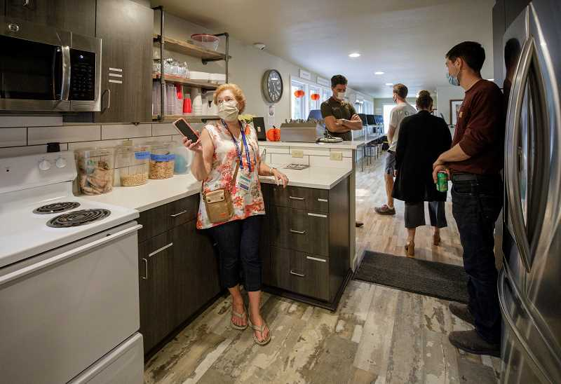 PMG PHOTO: JONATHAN HOUSE - Just Compassion volunteer Jeanne Jamison leads a tour of the renovated Tigard Resource Center, a facility that helps unhoused individuals with a meal, clothing, help finding a job or accessing mental health services.