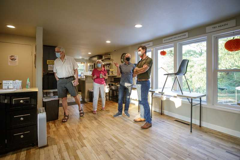 PMG PHOTO: JONATHAN HOUSE - A group checks out the renovated space at the Just Compassion Resource Center.
