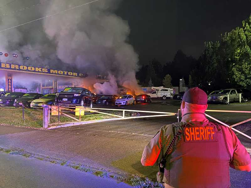 COURTESY PHOTO: CCSO - Deputies arrived to find multiple vehicles ablaze in the secured lot of the car dealership at 18777 S.E. McLoughlin Blvd.