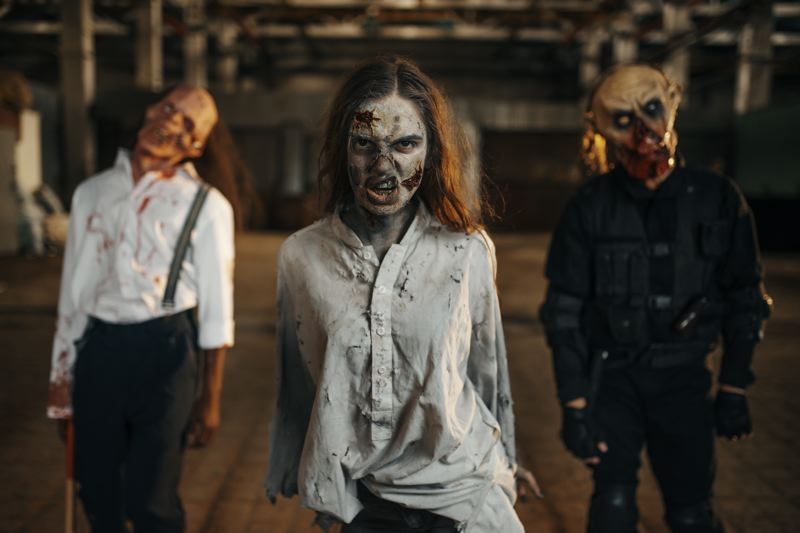 COURTESY PHOTO - Zombies are out to get you at the Oaks Park Haunted Drive-Thru at Oaks Amusement Park.