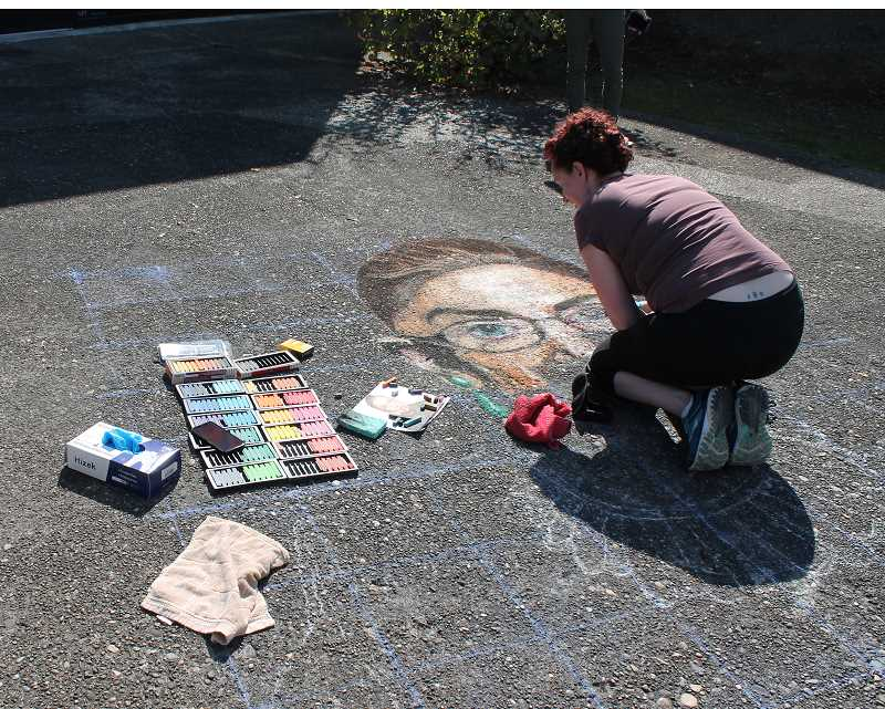 PMG PHOTO: HOLLY BARTHOLOMEW - West Linn artist Emra Nation depicts Ruth Bader Ginsburg in chalk.