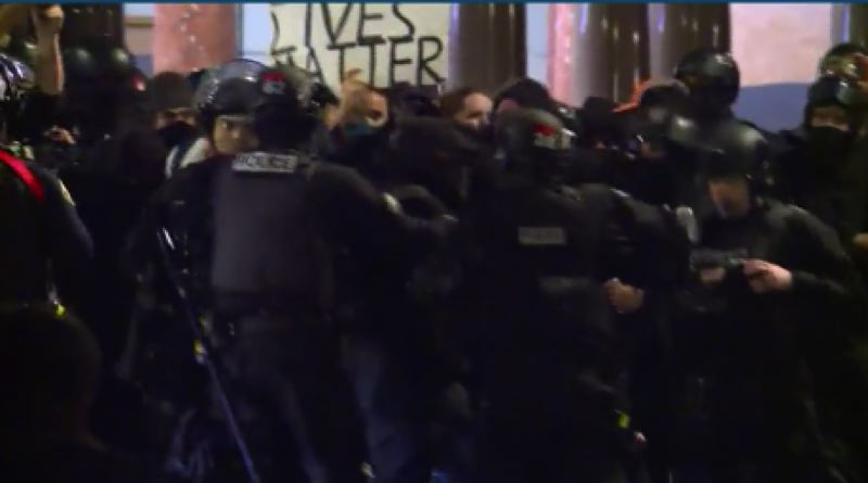 KOIN 6 NEWS - A protester being arrested at City Hall.
