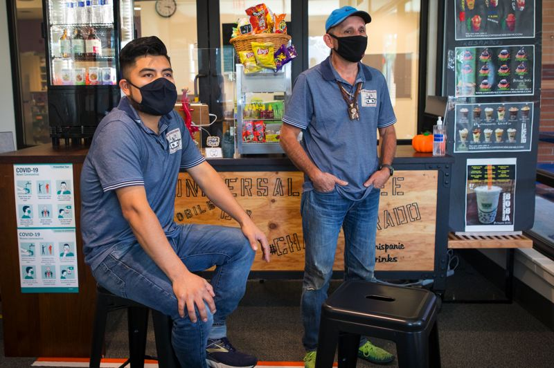 PMG PHOTO: JAIME VALDEZ - Juan Ruiz, left, and Alex Contreras, owners of Universal Coffee, stand in front of their mobile coffee bar located inside the Cornelius Public Library.