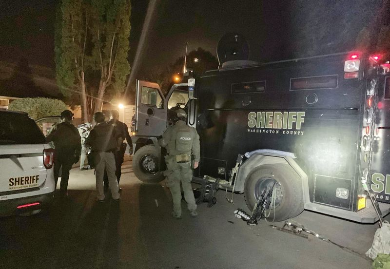 COURTESY PHOTO: WASHINGTON COUNTY SHERIFF'S OFFICE - Officers working with the Washington County Sheriff's Office's Tactical Negotiations Team and Crisis Negotiations Unit during an armed standoff outside an Aloha home Sept. 26.