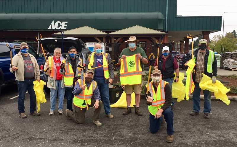 COURTESY PHOTO: JIM MORRIS - Forest Grove Rotary members gather at Ace Hardware in Forest Grove prior to collecting trash on Highway 47 between TV Highway and B Street.