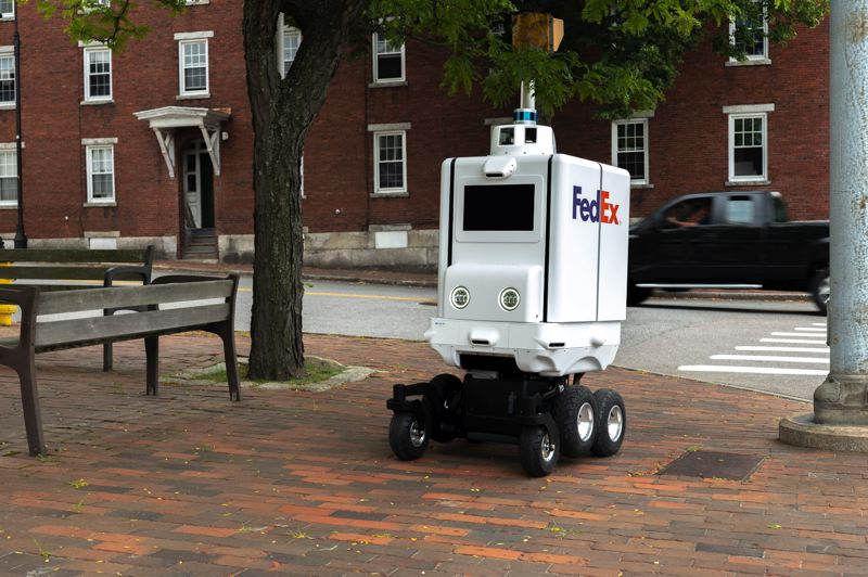 COURTESY PHOTO: FEDERAL EXPRESS - FedEx's same day delivery robot will be working with thousands of new human hires to beat the fall shopping season rush.