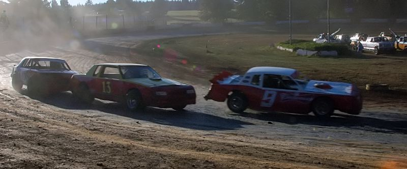 COURTESY PHOTO: MIKE WEBER - Warren's Terry King (center) races to victory in the Sportsman Division main event at the Columbia County Racing Association's season finale on Saturday, Oct. 3.