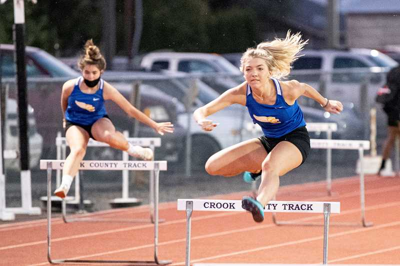 LON AUSTIN - Eliot Moore clears a hurdle during the 100-meter high hurders. Moore won both that race and the high jump competition in the meet with Culver at Crook County Oct. 1.