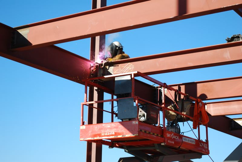 COURTESY PHOTO: HILLSBORO SCHOOL DISTRICT - A welder works to construct the Hillsboro School District's new elementary school in North Plains.