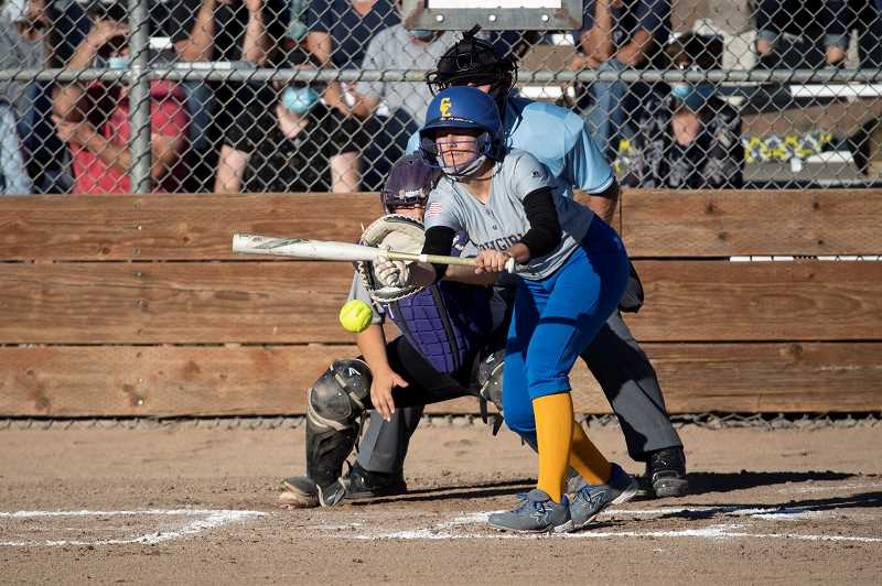 LON AUSTIN - Tylee Cossitt squares to bunt against the Ridgeview Ravens last week. The Ravens, who won the 5A state title in 2019, are still plenty talented. They beat a scrappy Crook County squad 15-0 in Prineville Sept. 28 then 13-3 in Redmond Sept. 30.