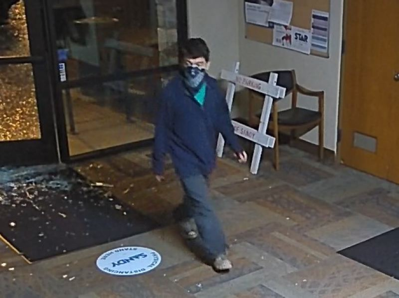 COURTESY PHOTO: CITY OF SANDY - Security cameras at Sandy City Hall caught an image of the suspect, who appears to be male, though the identity of this person remains unknown.