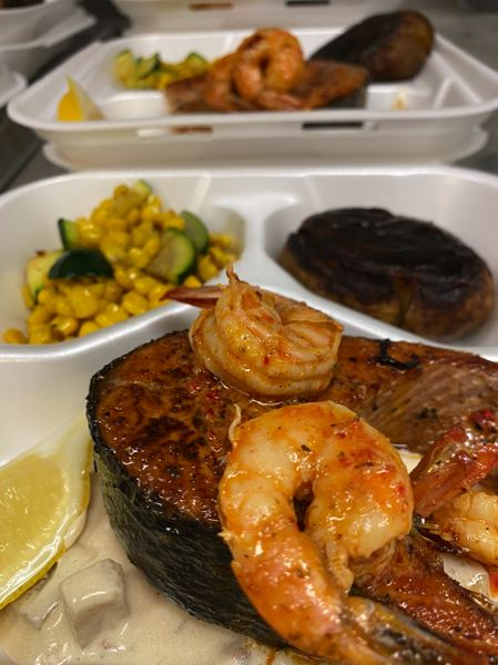 COURTESY PHOTO - Chef Dominic Sachet is locally famous in Sherwood for his many delicious meals, such as this surf and turf dinner of steak and prawns, served with sumptious sides.