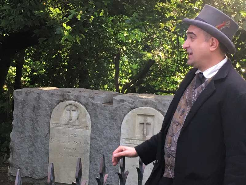 COURTESY PHOTO - Oregon City Commissioner Rocky Smith tours the graves of John McLoughlin and Marguerite McLoughlin.